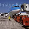 GW13545-50 = Scene at Palma de Mallorca Airport ( Tui / Britannia Boeing 757-204 Registration G-BYAT commencing pushback under the guidence of Iberia lady despatcher ), Baleares, Spain.
